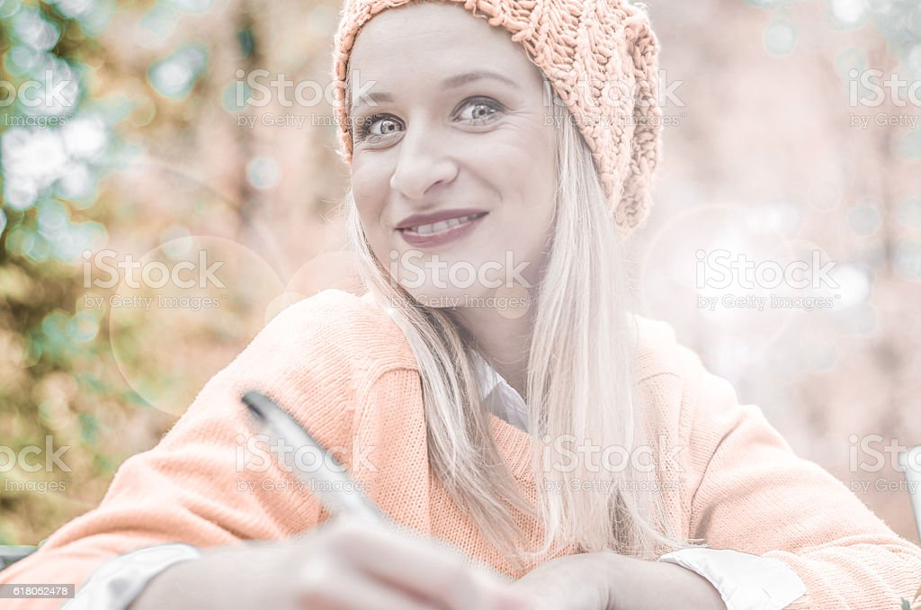 hipster girl writes a diary or log outside in nature stock photo