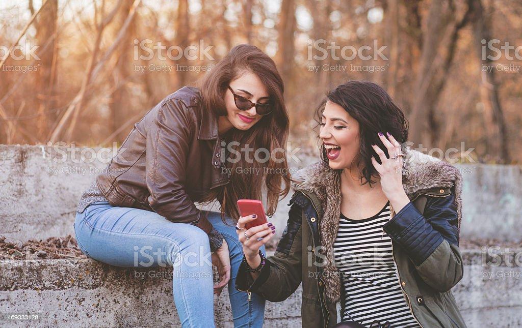 Hipster girls having fun and taking selfies stock photo