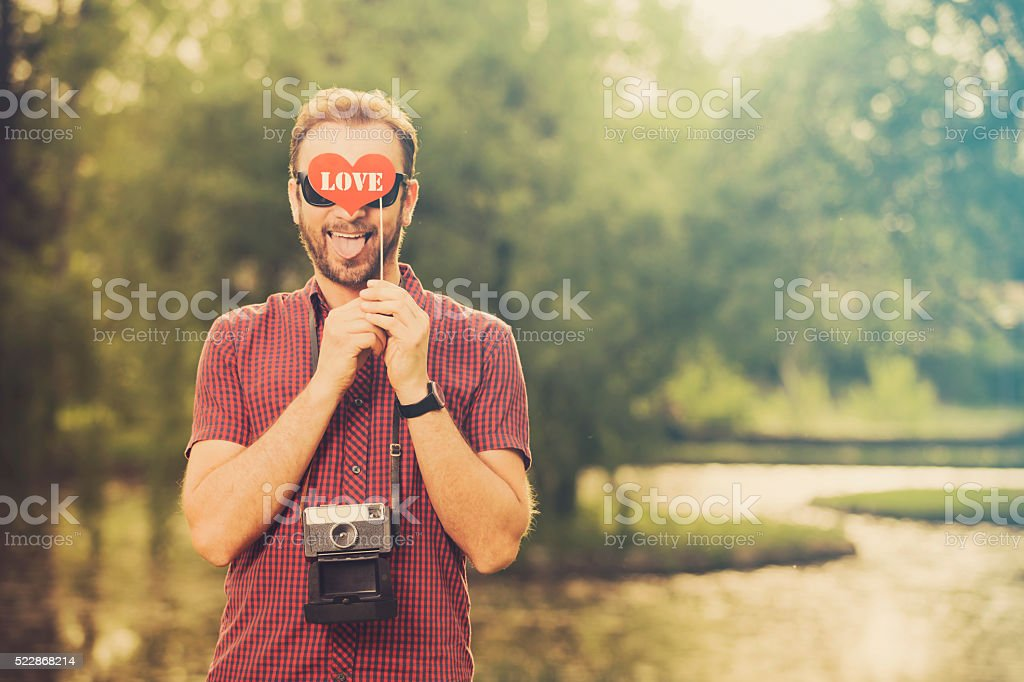 Hipster guy enjoy outdoors. Love is all around. stock photo