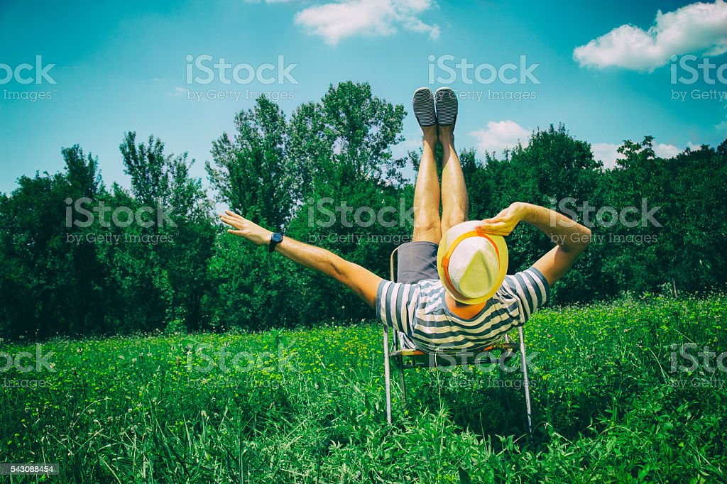 Hipster guy having fun in nature. stock photo