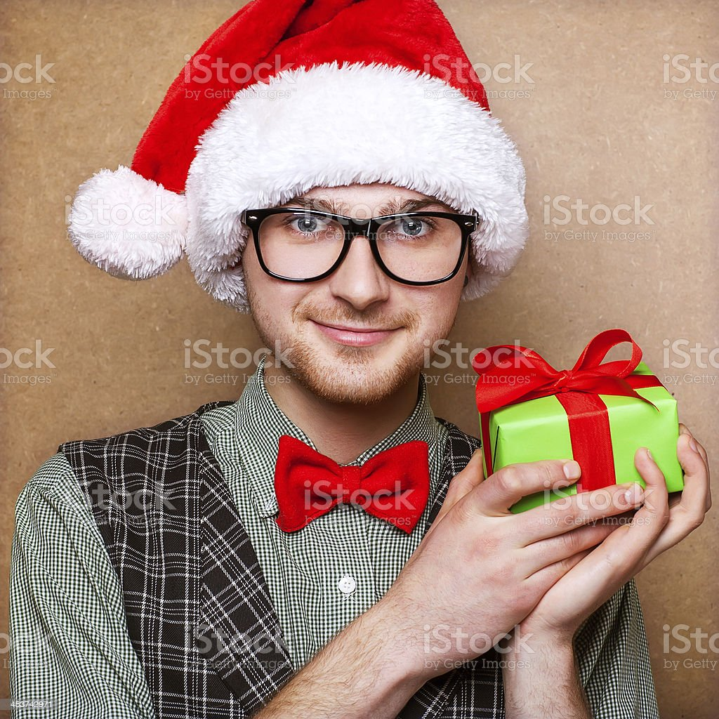 Hipster guy in the hat of Santa Claus royalty-free stock photo