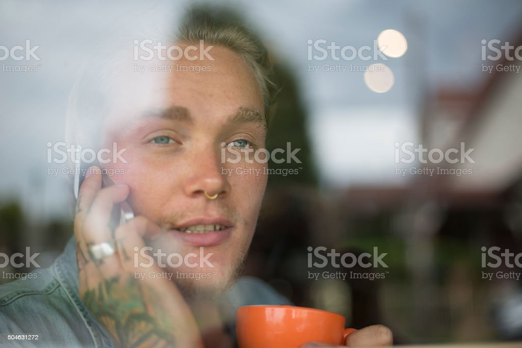 Hipster guy on mobile phone stock photo