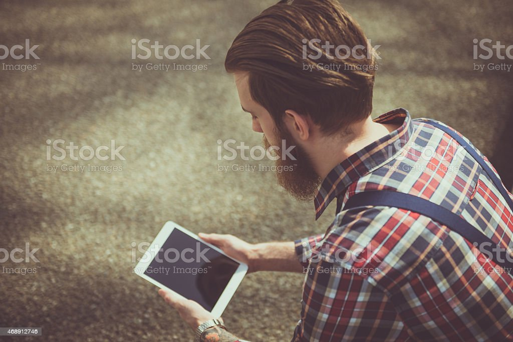 Hipster Guy Reading at Park stock photo