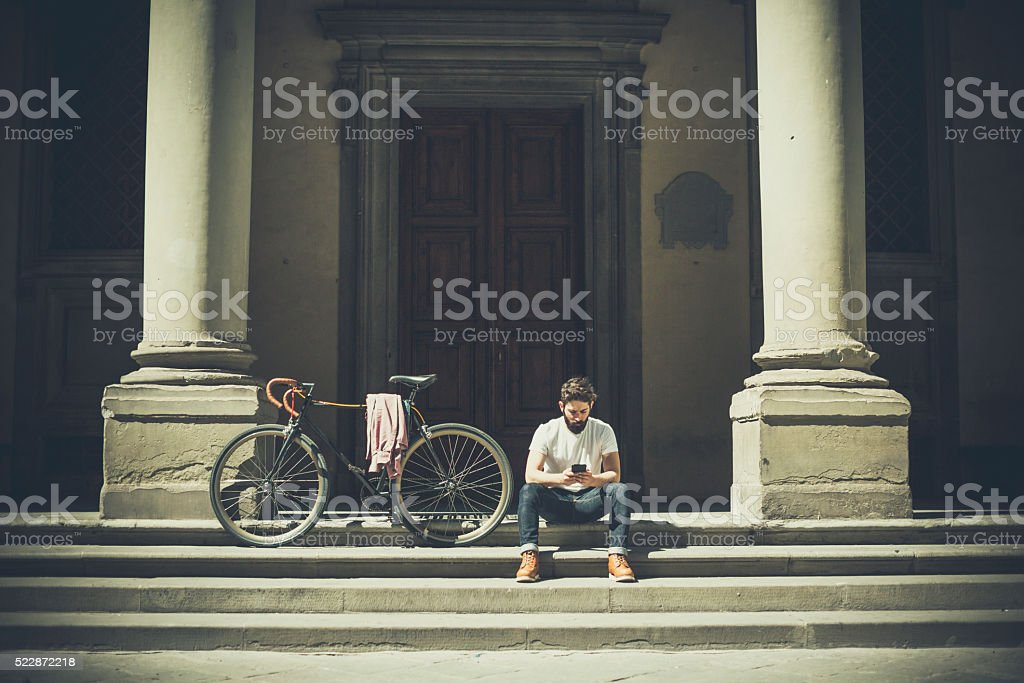 Hipster guy with bicycle in Florence stock photo