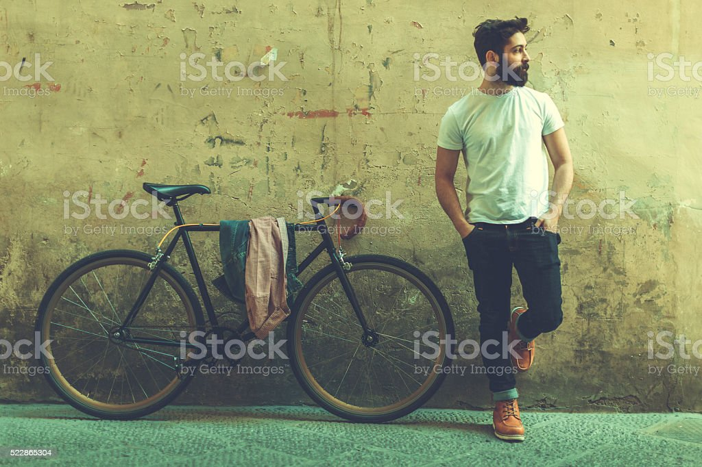 Hipster guy with bicycle in Italy stock photo