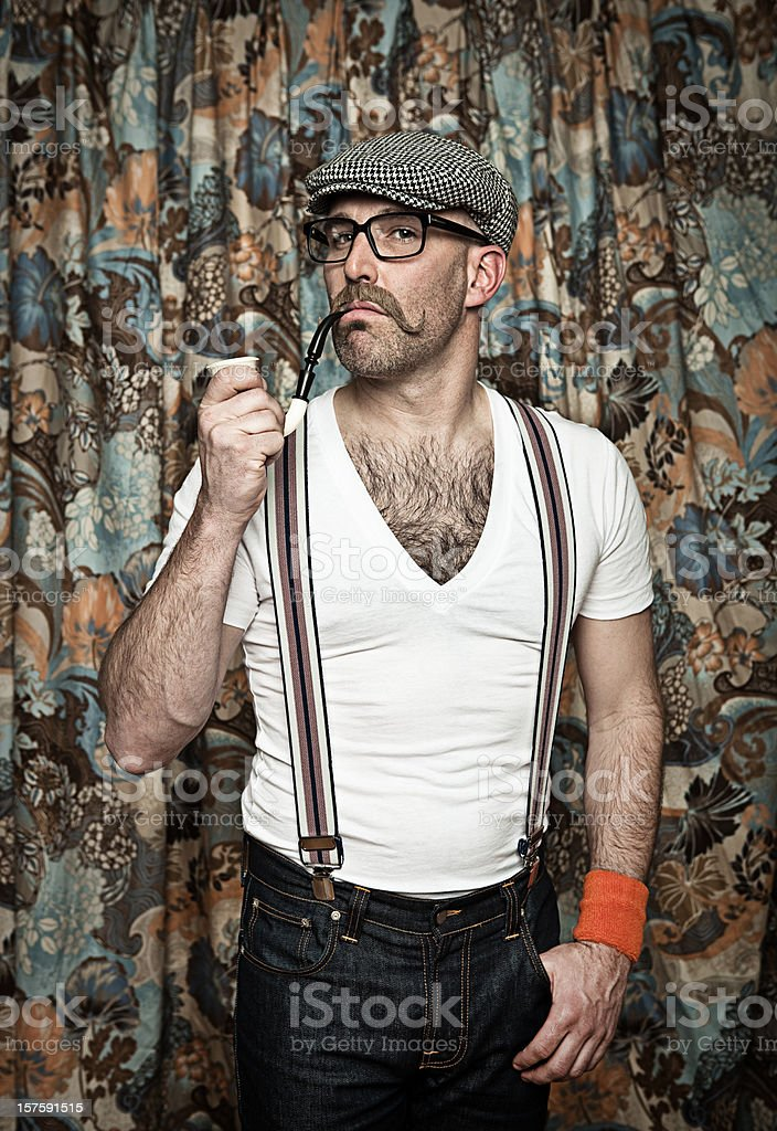 Hipster in glasses smoking a pipe stock photo