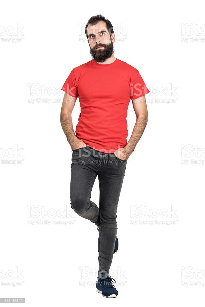 Hipster in red t-shirt standing and balancing on one leg stock photo