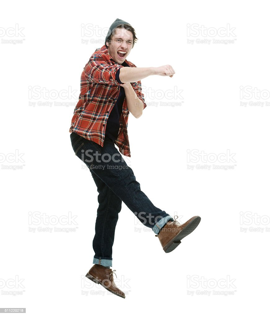 Hipster jumping and punching stock photo