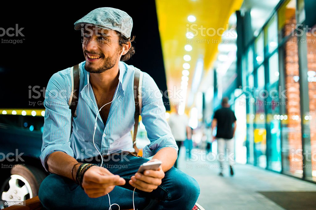 Hipster listening music stock photo