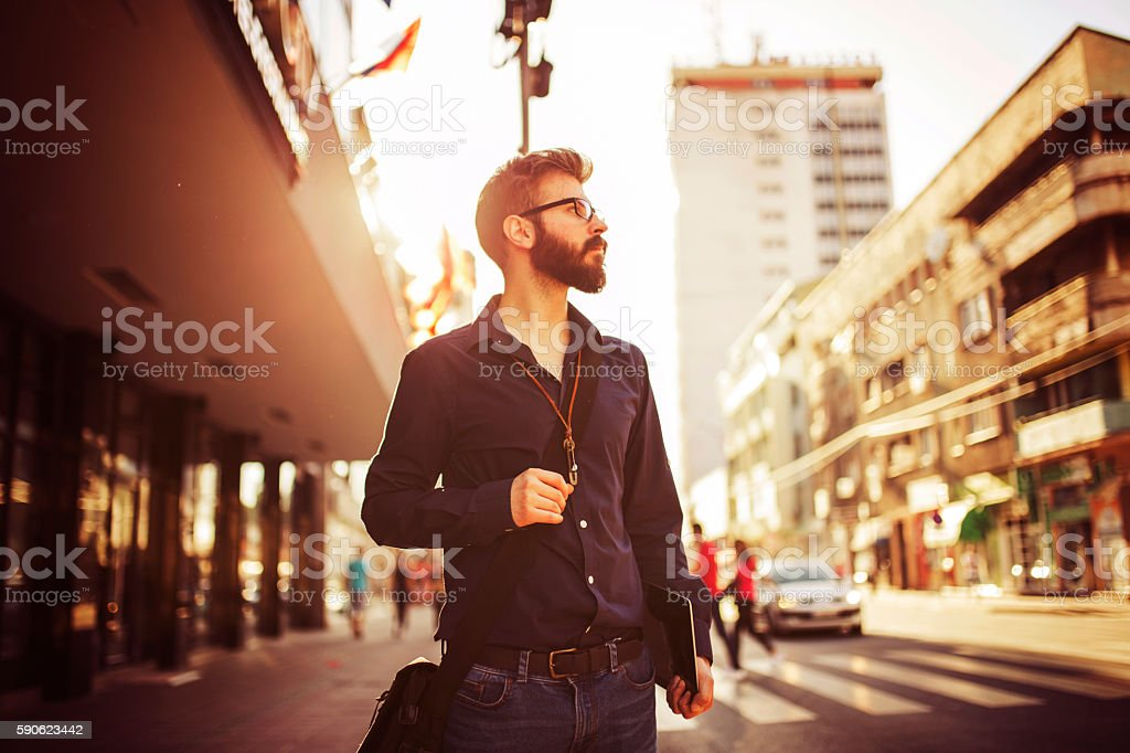 Hipster looking at traffic light stock photo