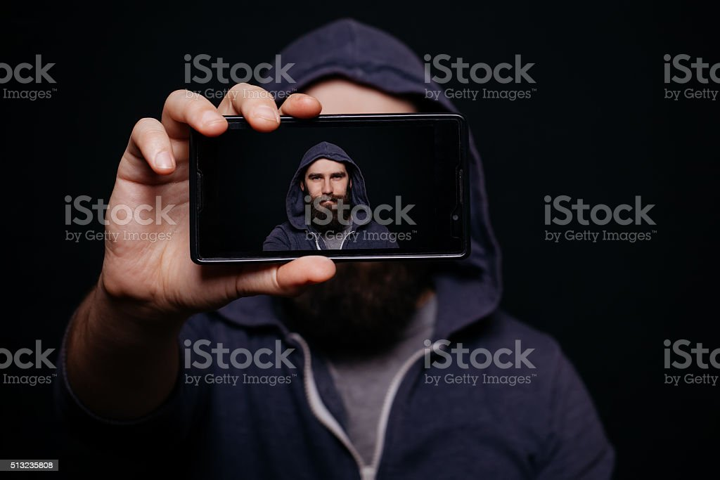 Hipster man beard taking picture smartphone self-portrait, screen view stock photo