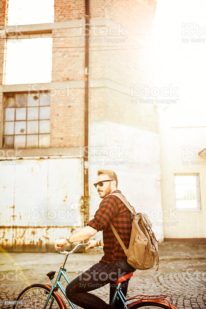 Hipster man on the bike, depth of field, stock photo