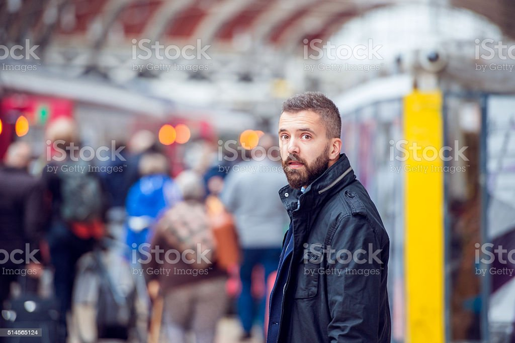 Hipster man waiting at the crowded train station stock photo
