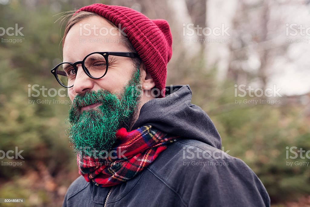 Hipster man with glitter beard ready for holiday season outdoors. stock photo