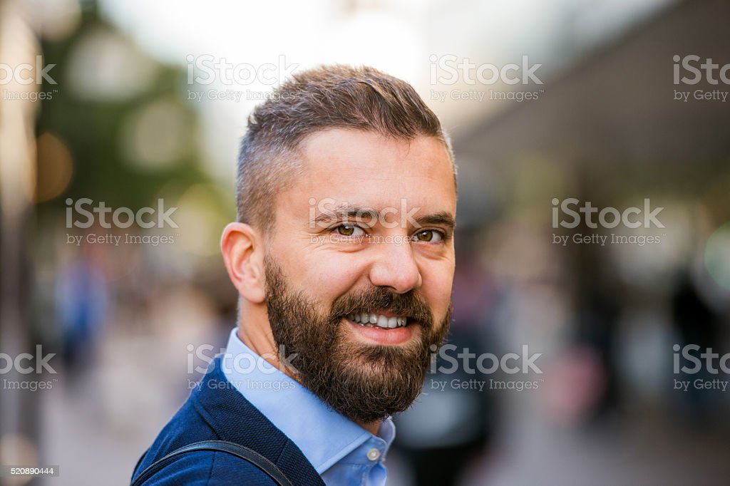 Hipster manager in blue shirt walking in the street stock photo