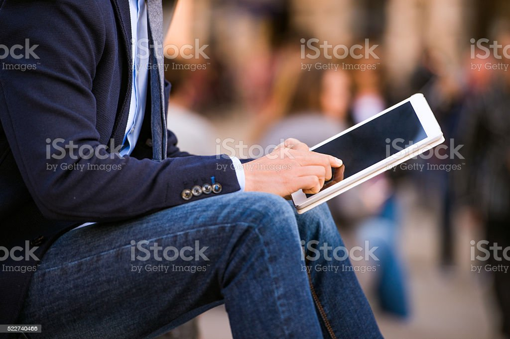 Hipster manager with tablet, Piccadilly Circus, London stock photo