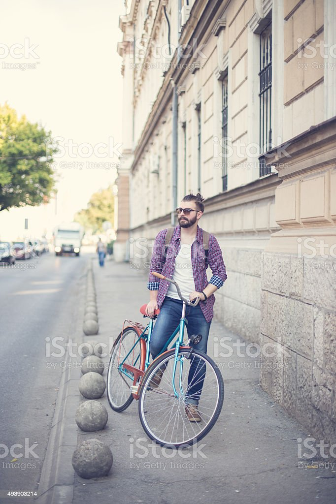Hipster mand with beard and his  bike outdoors stock photo