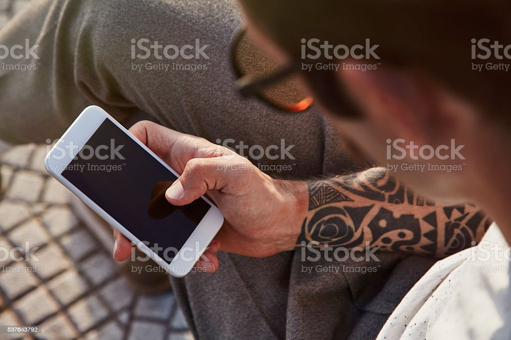 Hipster Men Using Smartphone at Park stock photo
