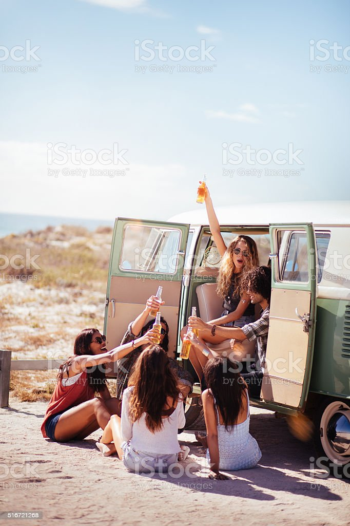 Hipster Multi-Ethnic Group Sitting in Back of Van Drinking Beer stock photo
