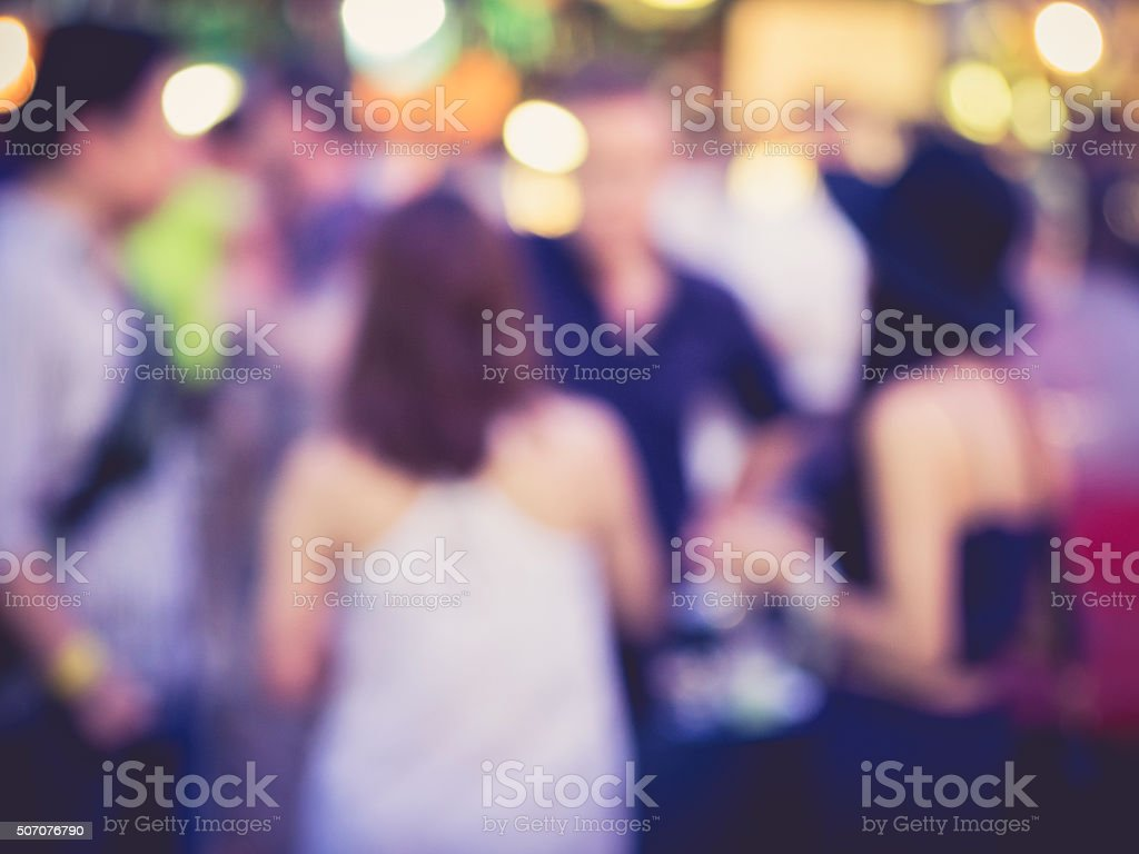 Hipster Party Men and women in Festival Event Blurred Background stock photo