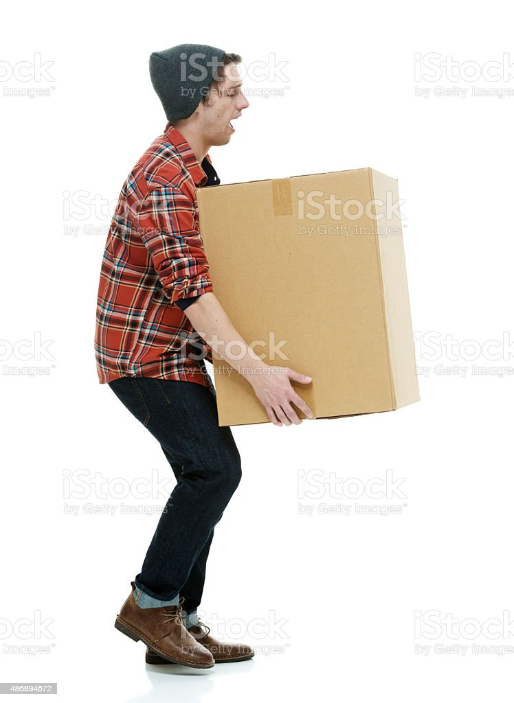 Hipster picking up package stock photo