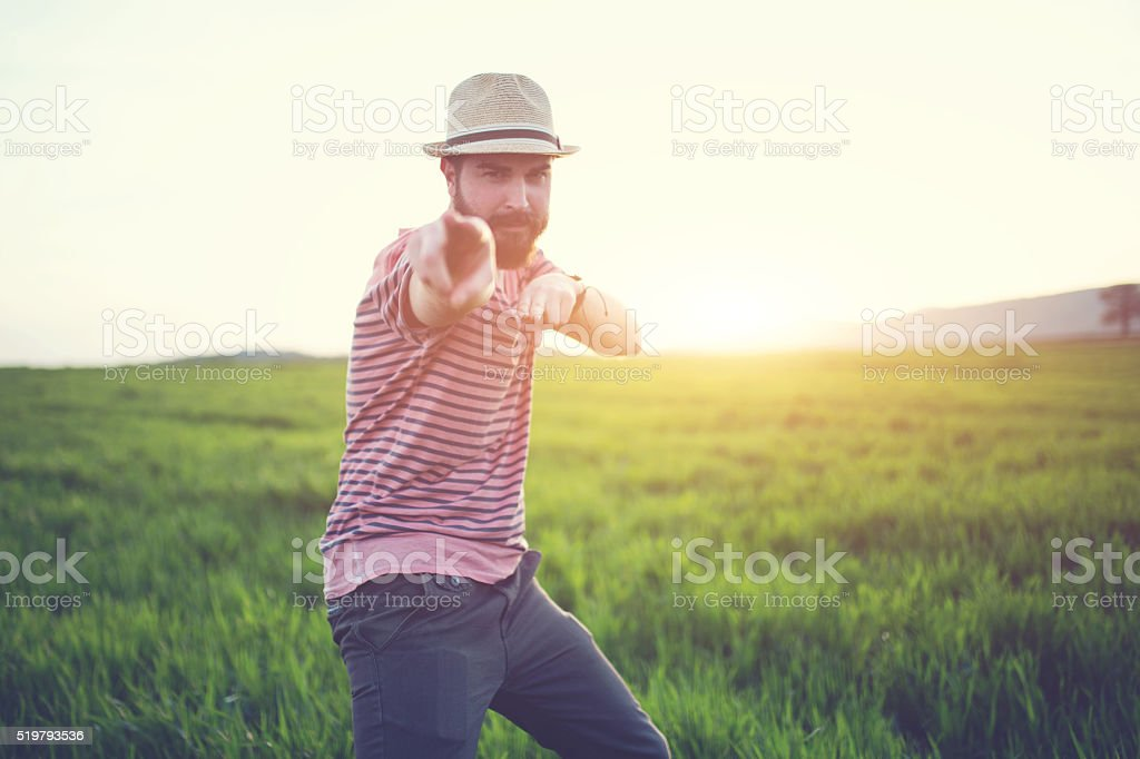 Hipster pointing at you stock photo