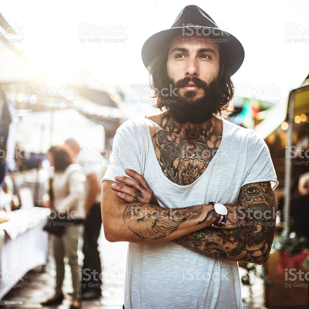 Hipster portrait with body full of tattoo stock photo