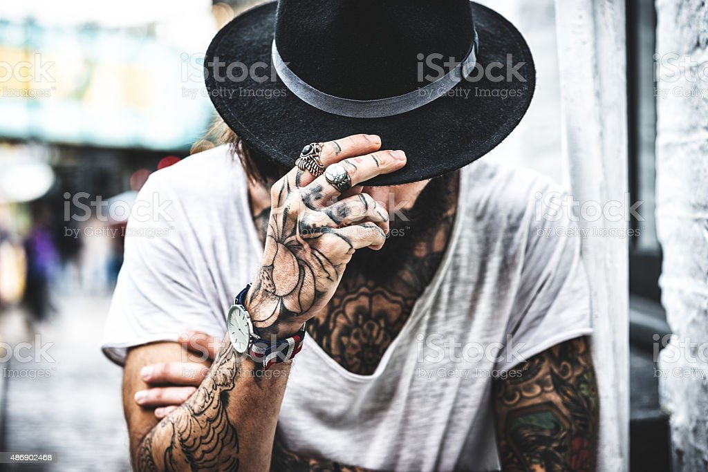 Hipster portrait with tattoo stock photo