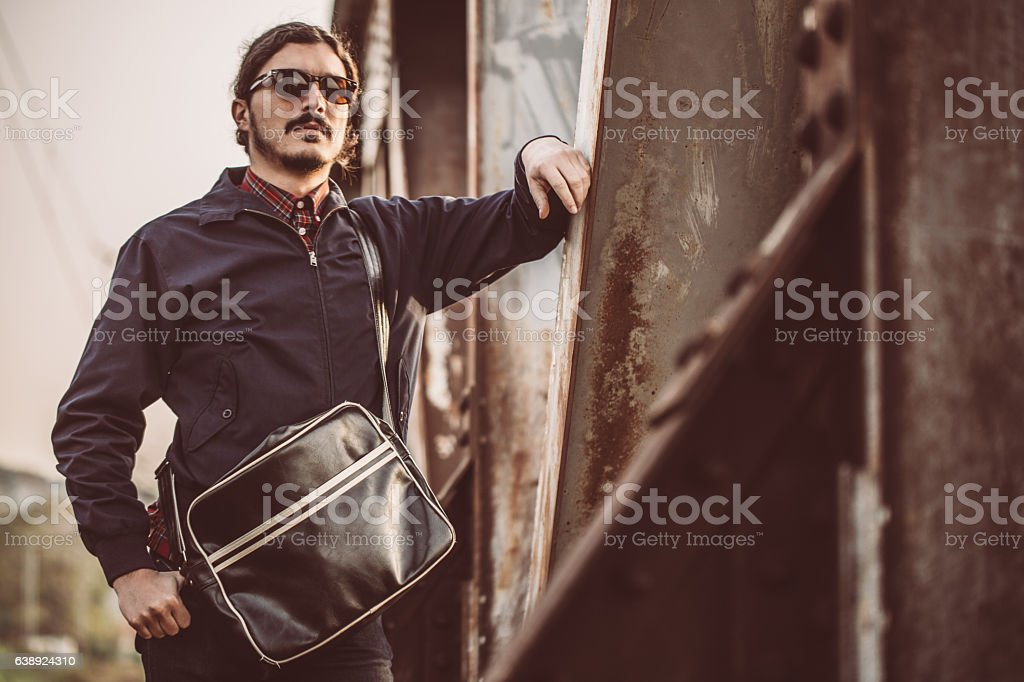Hipster relaxing outdoors stock photo