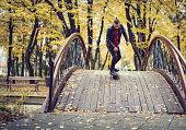 Hipster riding skateboard