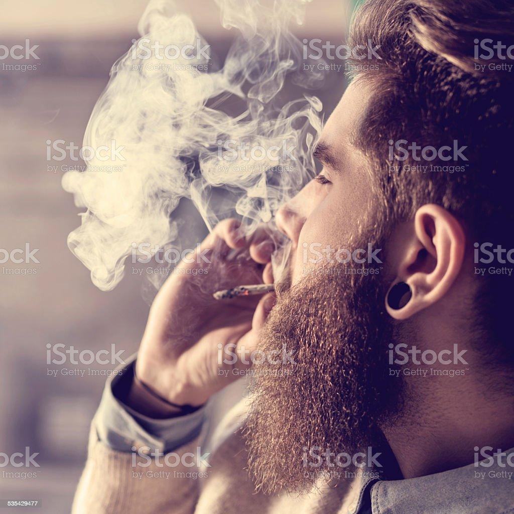Hipster smoking pot. stock photo