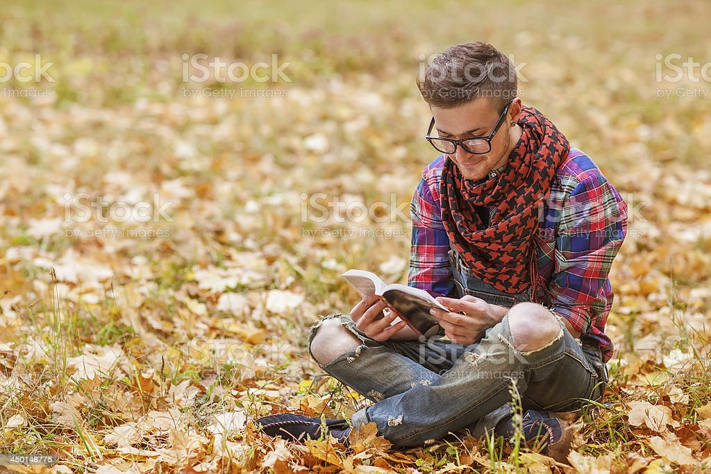 hipster standing in autumn park grin royalty-free stock photo