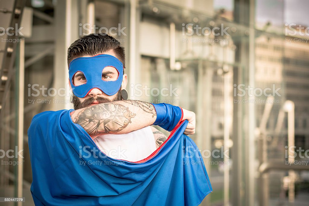 Hipster superhero in action stock photo