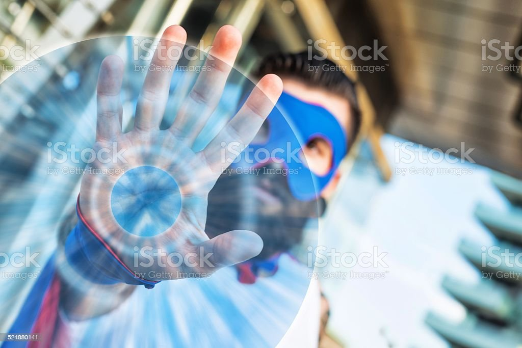Hipster Superhero Using Laser Shield stock photo