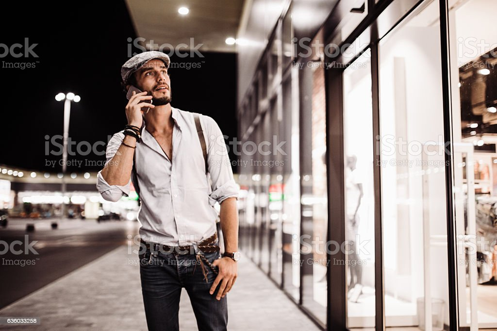 Hipster talks on his cell stock photo