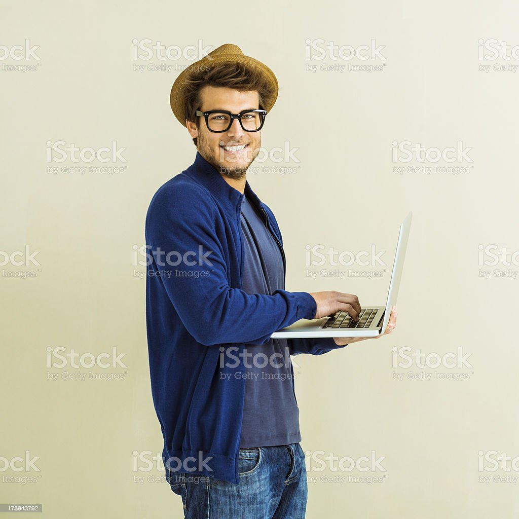 Hipster using laptop royalty-free stock photo