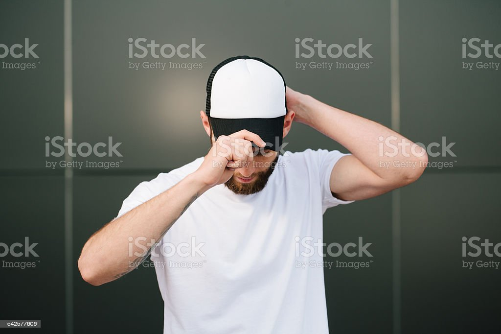 Hipster wearing white blank t-shirt with space for your logo stock photo