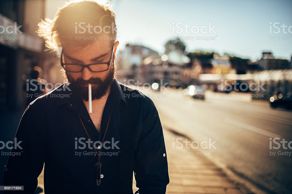 Hipster with a cigarette stock photo