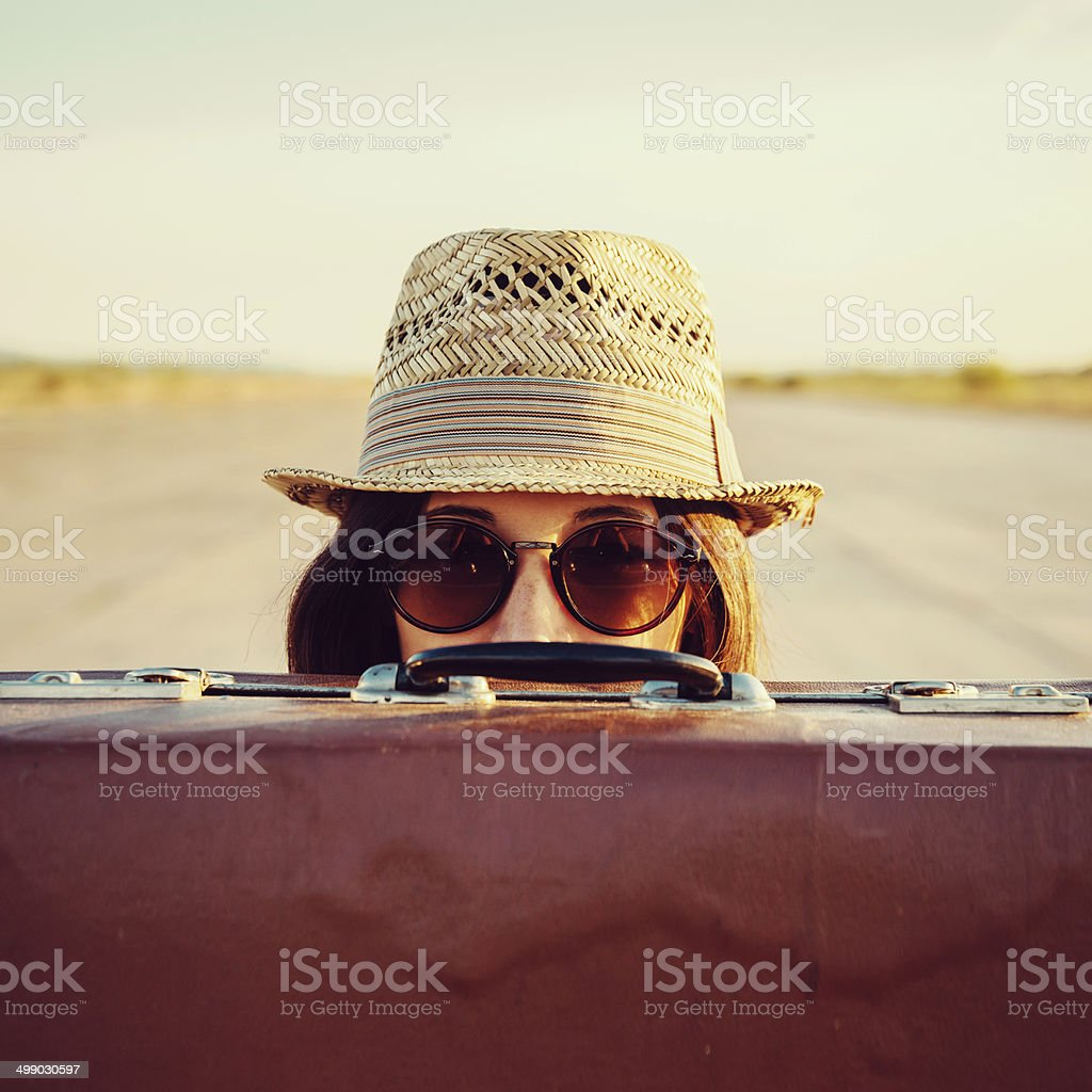 Hipster with suitcase stock photo