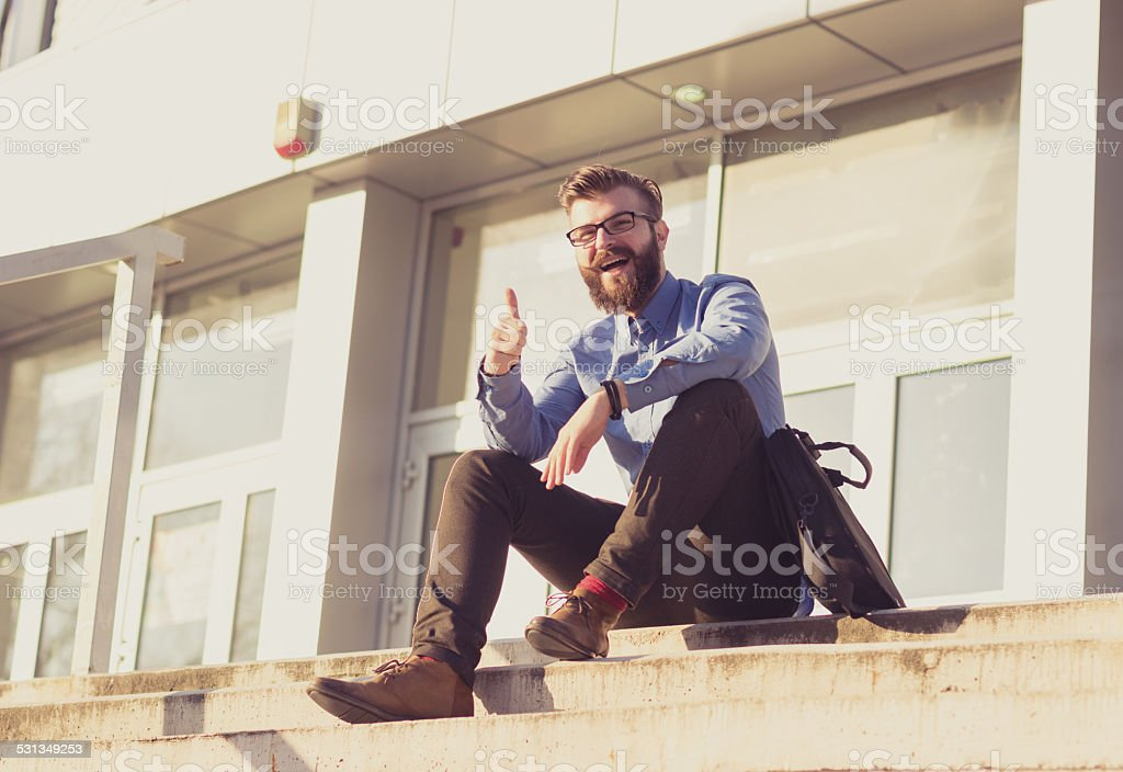 Hipster with tumb up stock photo