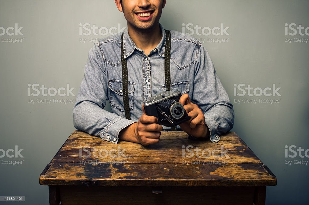Hipster with vintage camera at old desk royalty-free stock photo