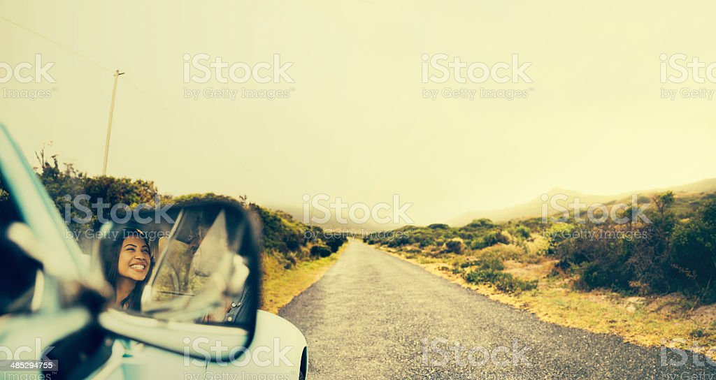 Hipster Woman on a road trip stock photo