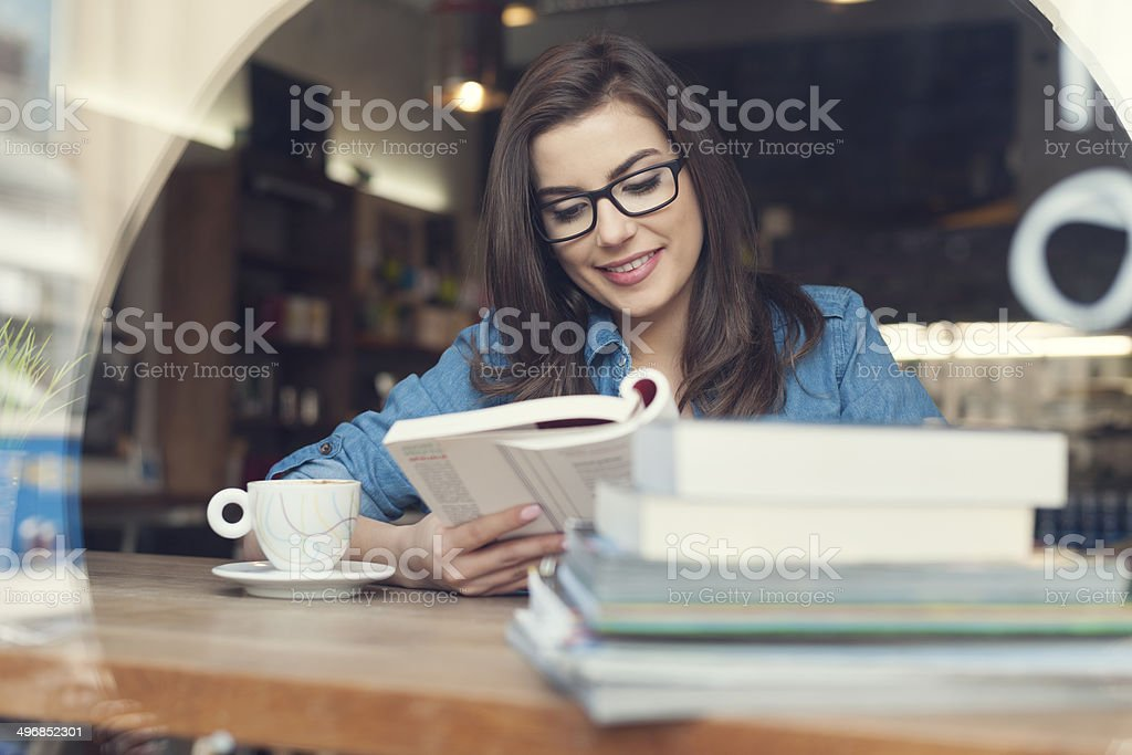 Hipster woman studying at cafe stock photo