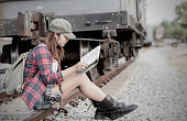 Hipster woman traveler holding map on hand.