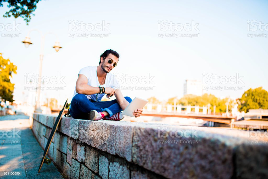 Hipster working on tablet stock photo