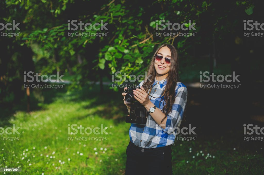 Hipster young adult girl taking a picture stock photo