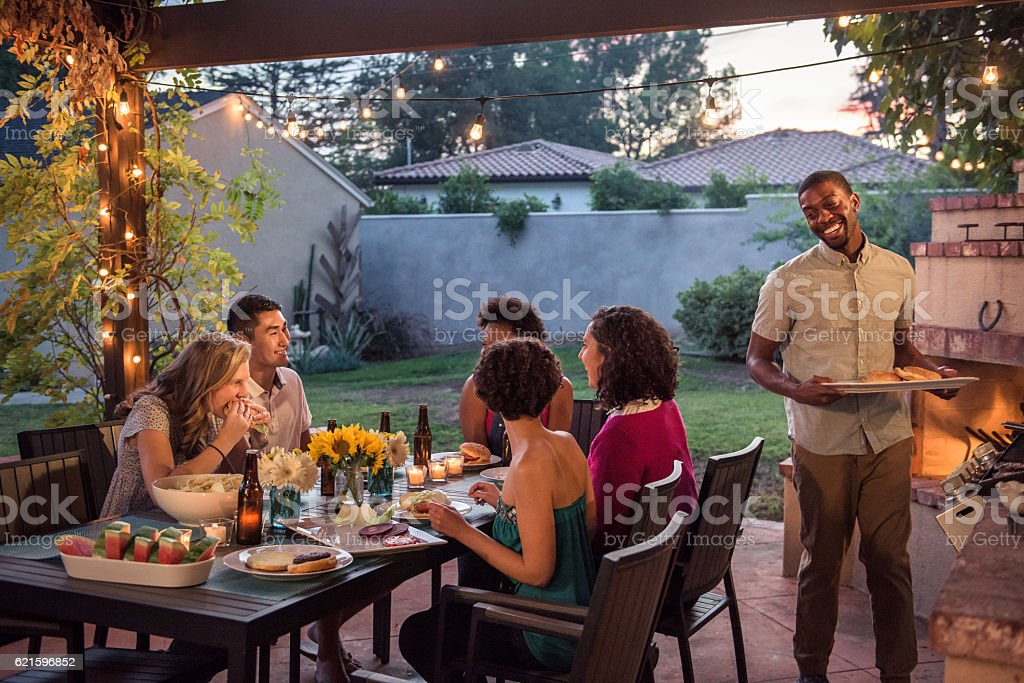 Hipsters Grilling at a Summer Backyard BBQ stock photo