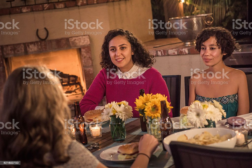 Hipsters Talking Around the table at a Summer Backyard BBQ stock photo