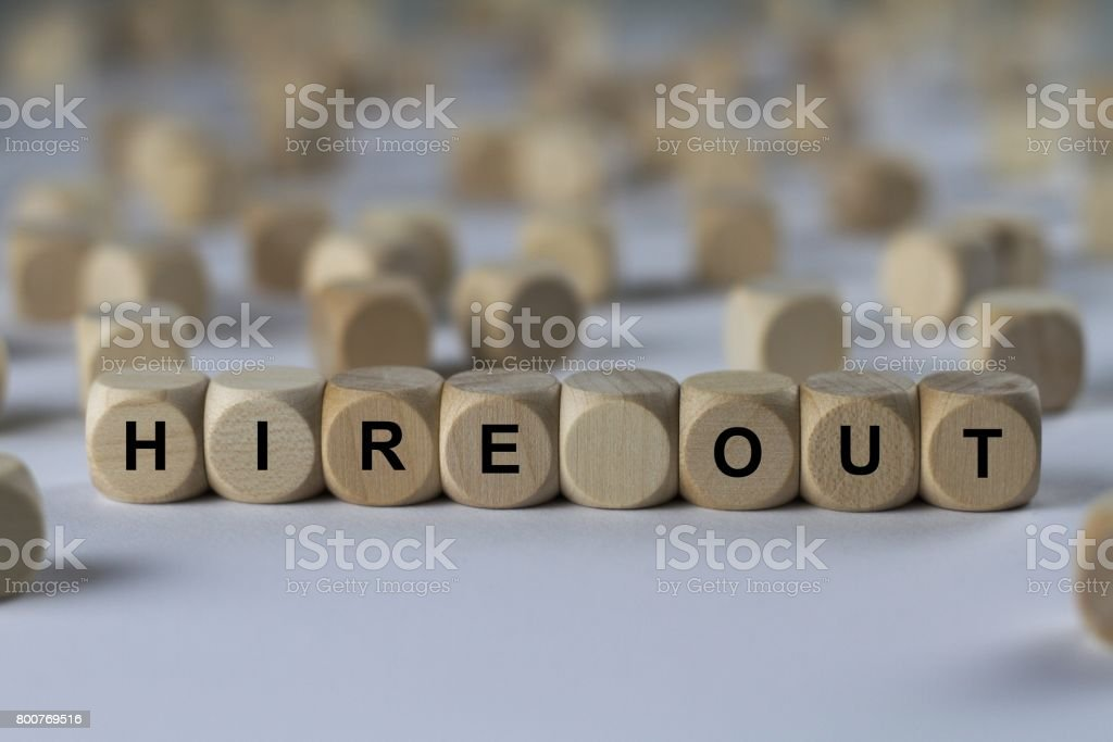 hire out - cube with letters, sign with wooden cubes stock photo