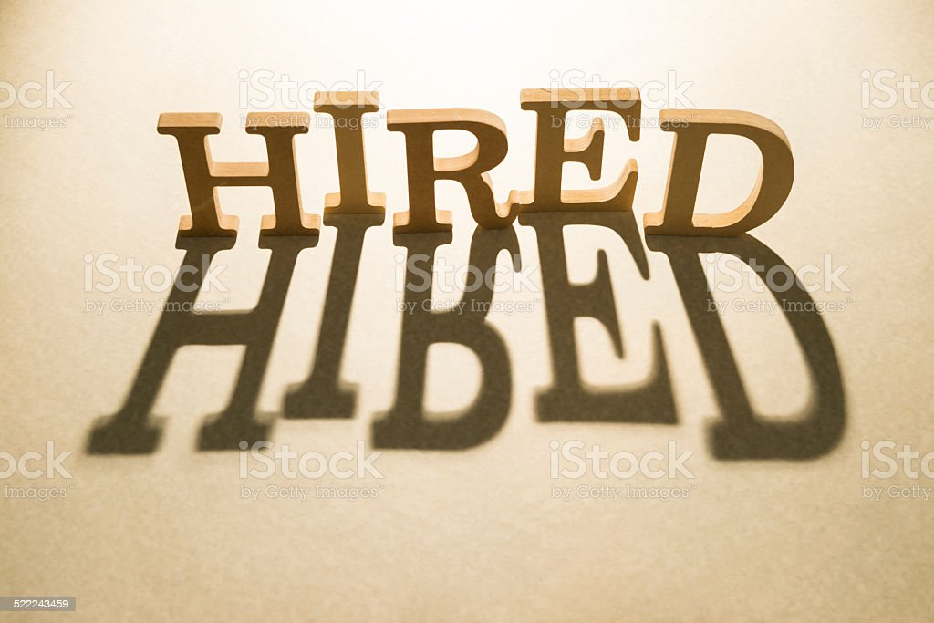 Hired concept and shadow stock photo